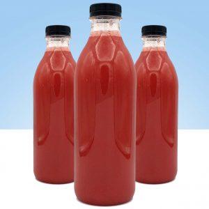 zumo natural recien hecho de fresa y frambuesa