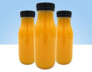 zumo recien exprimido mango naranja